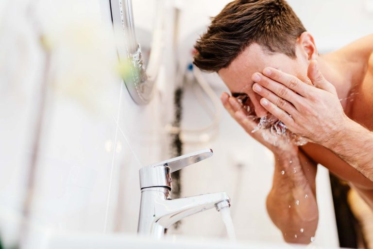 Man Washing his face with Salt-Free Conditioned Water