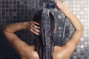 Woman enjoying Conditioned Water in the shower