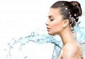 Woman enjoying her Water Softening System